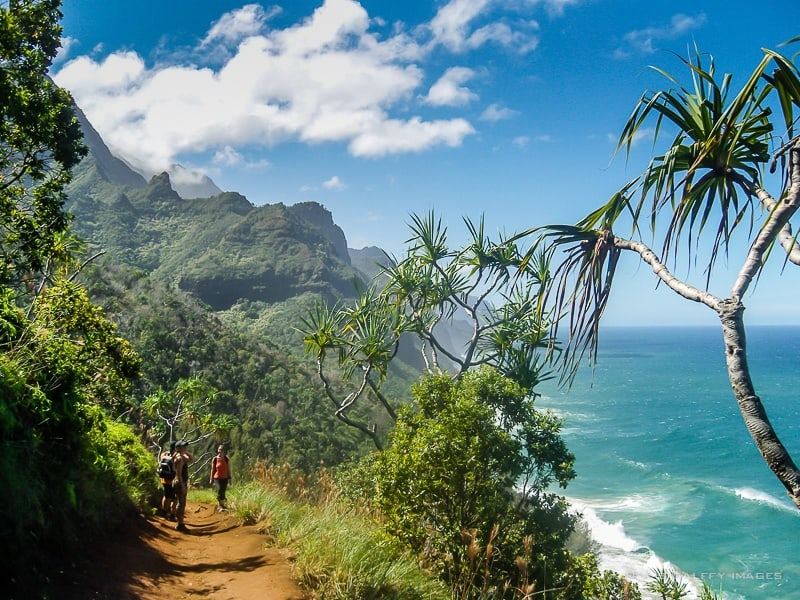Image depicting hikers hiking kalalau trail