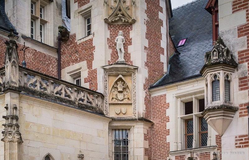 Brick and tufa stone façade at Chateau Clos Luce