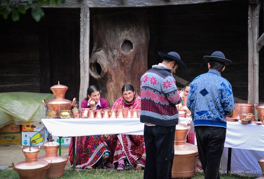 Gypsies selling metal crafts at Bucharest Village Museum