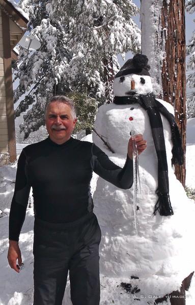 Building a snowman in winter