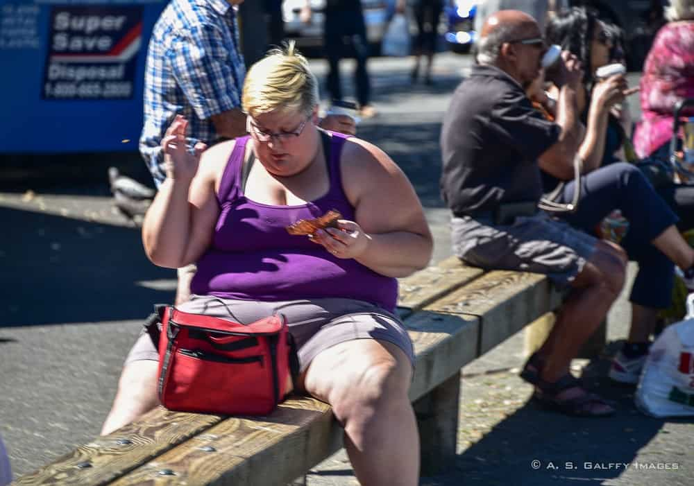 Obese woman eating - a culture shock in America