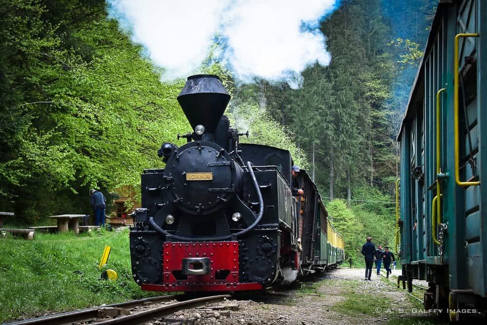 locomotive blowing up steam