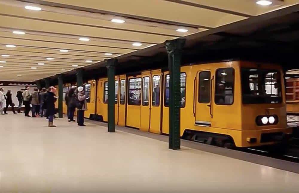 view of the Millennium metro entering the station in Budapest