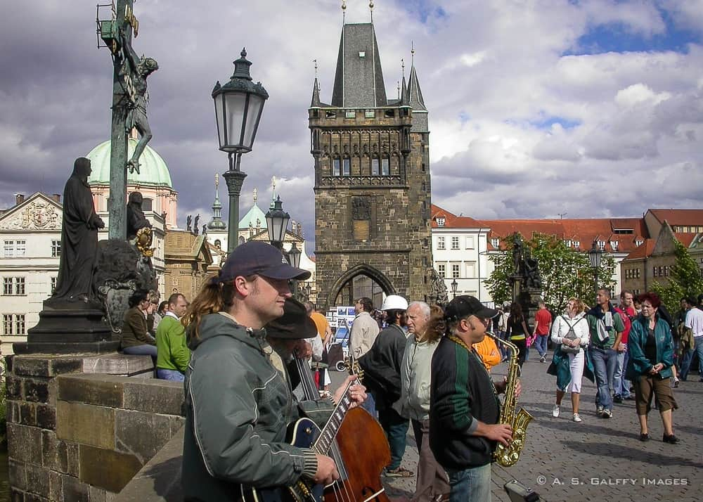 caption of musicians performing on Charles Bridge in Prague