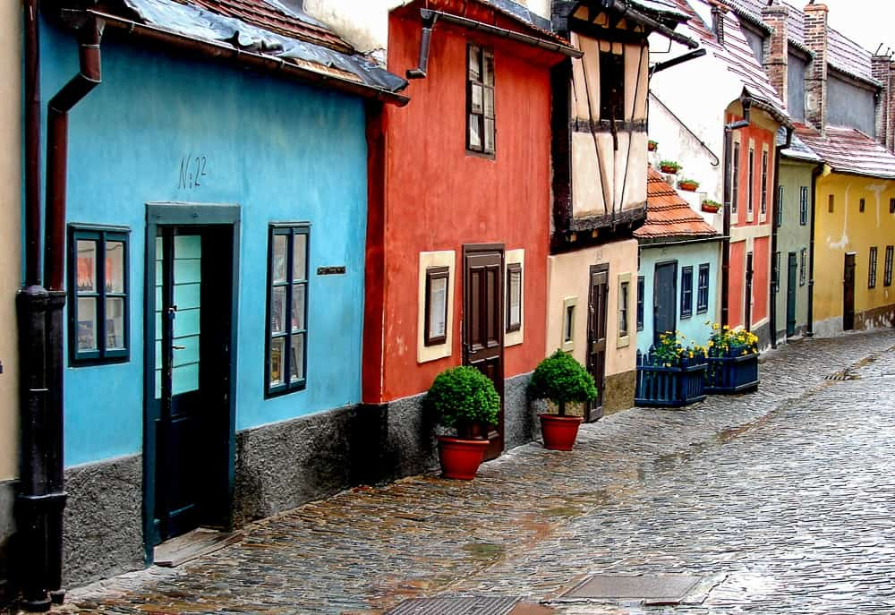 caption of the Golden Lane in Prague with colorful little houses of the craftsmen in the 17th century