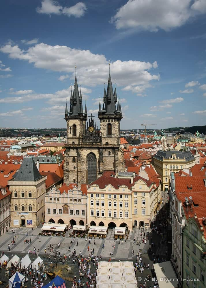 caption of Tyn Church towering the Old Town Square in Prague