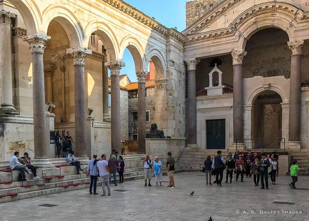 Cathedral of St. Domnius (on the left) with the only sphinx that remained intact