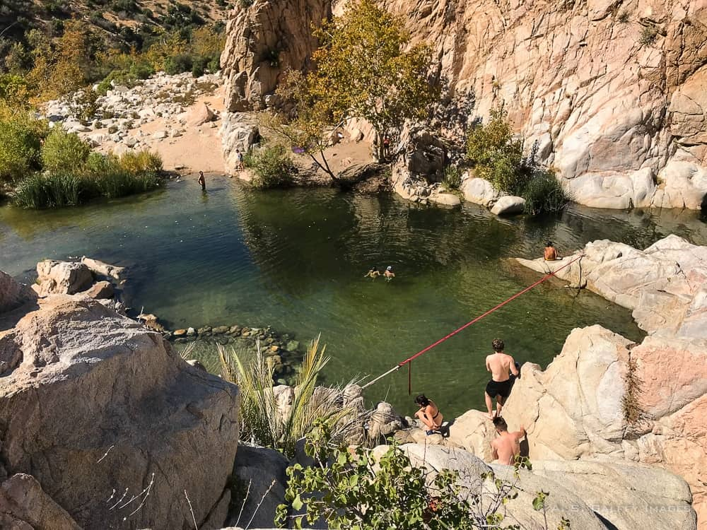 View of people swimming at the Deep Creek Hot Springs
