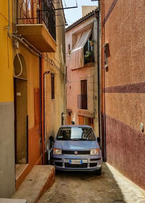 Car parked in narrow alley in Sicily