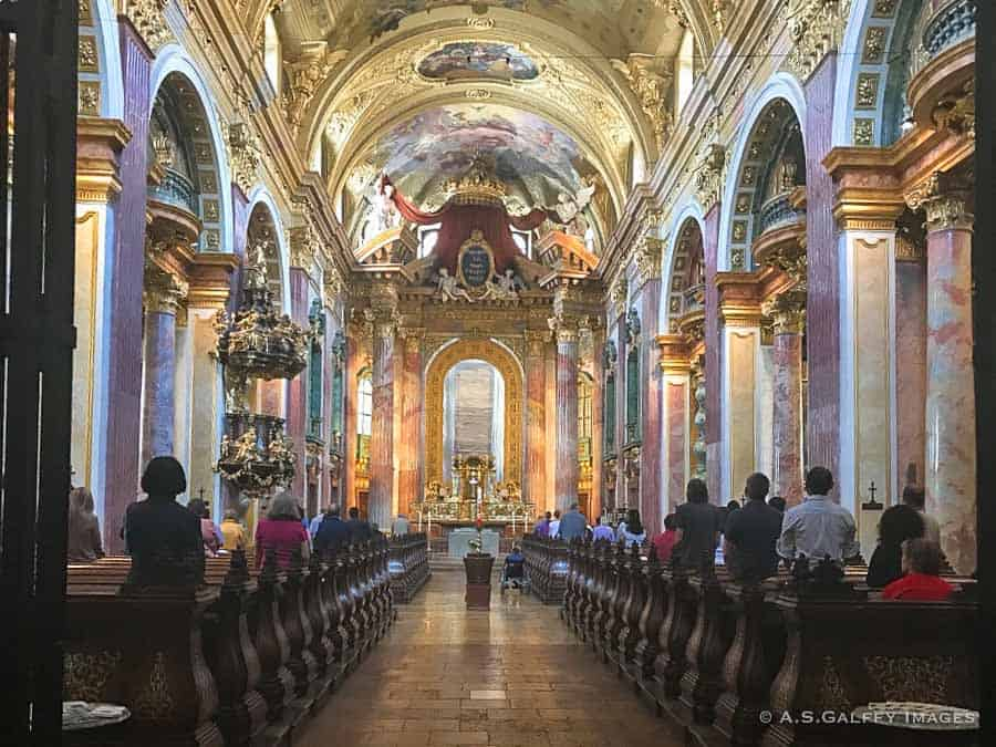 The brightly decorated nave of the Jesuite Church in Vienna