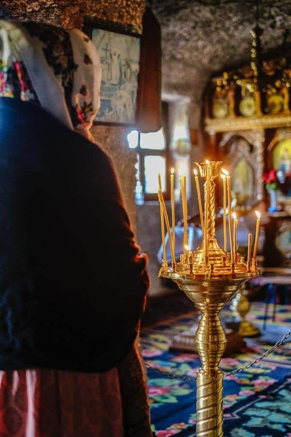 woman praying in an Orthodox Church - Romanian Religious Culture