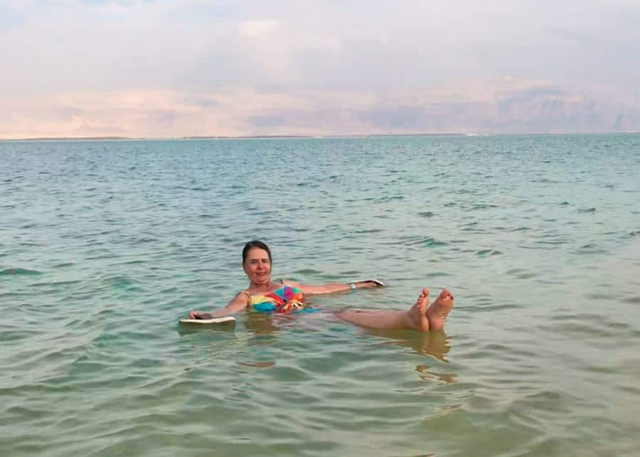 floating in the Dead Sea on a day trip from Tel Aviv