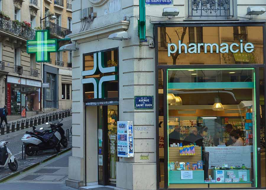 Paris pharmacy displaying cosmetics and perfumes in the window.