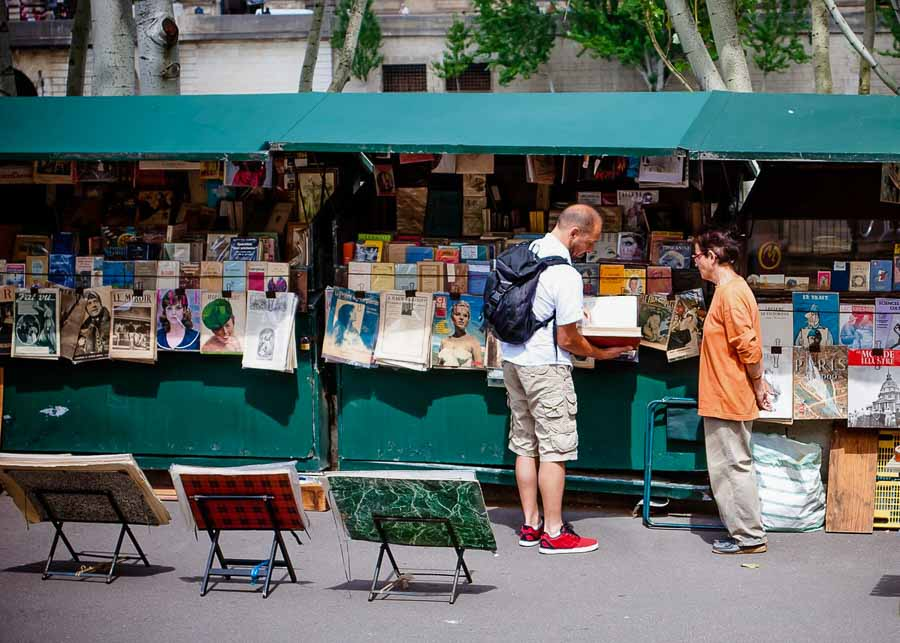 Buying odd French souvenirs from the riverside Bouquinistes