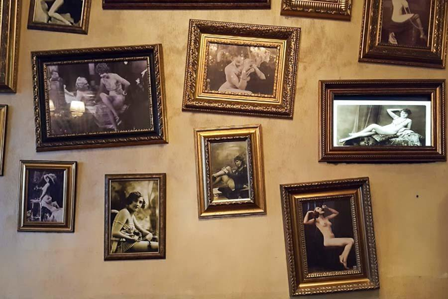 Nude photographs from the 1920s on the wall at Bordello Bar
