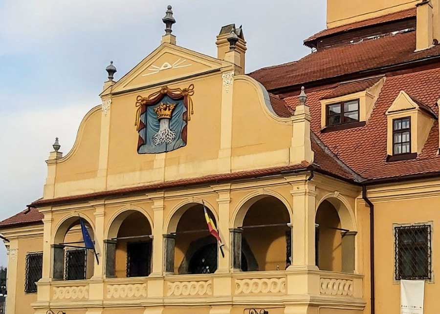 Brasov's coat of arms on the façade of the City Council building