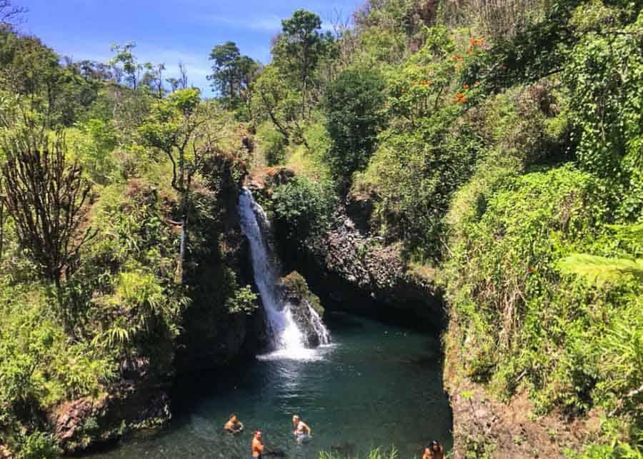 People swimming in the Pua'a Kaa falls